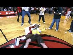 Check out this wild highlight of one lucky Heat fan who throws up a one-handed hook shot from half court and sinks it for 75,000 dollars, much to the delight of all the fans & players in the arena, especially LeBron James, who storms the court and tackles him!