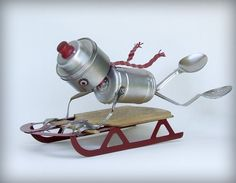 Sledding robot - 99% recycled art - downhill sledding - fine art sculpture