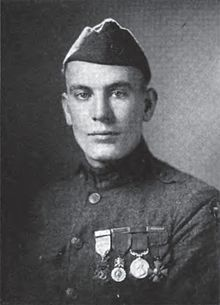 Corporal Thomas Pope - His company was advancing behind the tanks when it was halted by hostile machinegun fire. Going forward alone, he rushed a machinegun nest, killed several of the crew with his bayonet, and, standing astride his gun, held off the others until reinforcements arrived and captured them. July 4, 1918