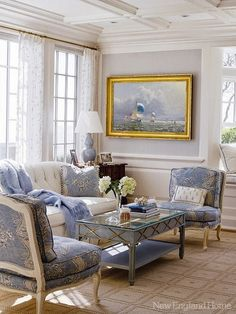 Splendid Sass.  Blue and white f a bric on chairs.