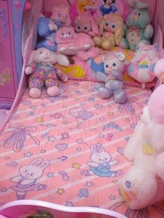 Omgosh! The purple and white one in the front was one of my favorite stuffed animals as I little kid that I named Star Bright. And I still have it :) I remember the stars on it were glow in the dark!