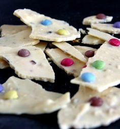 mendiants-Eclat-chocolat-blanc-smarties-noisettes Idees cadeaux gourmands
