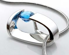 Argentium silver and Swiss blue topaz pendant designed by David Worcester for VerbenaPlace.Etsy.com