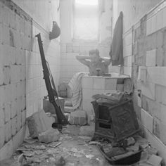 A soldier takes advantage of the opportunity to have a bath in Tobruk, 17 February 1942.