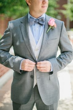 Sharp 3 piece wedding suit with bow tie #grey #vest #groom  Photo by: Megan Thiele Studios on Southern Weddings