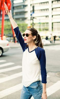 Baseball top, jeans, sunglasses and a ponytail. Simple, effortless, comfy but stylish