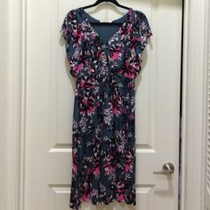 Boden floral dress Lovely, feminine, floral dress from Boden with v-neck, empire-waist, midi-length dress with flutter sleeves. Worn 2 or 3 times. Size 12. Boden Dresses