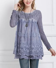 This tunic sports a sheer overlay and crocheted details for texture, and the sheer overlay lends a softness to the look. And, there's even sparkle with the metallic threads woven into the bodice.