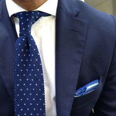 Blue flecked knit tie.