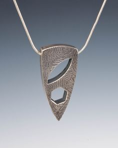 Hollow form pendant - would be interesting to make a multitool into jewellery