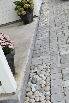 Pavers of a few different small sizes mix with river stone to create a rich effect, simply executed.