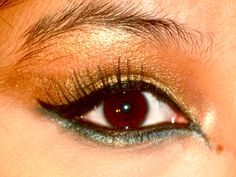 gold and turquoise egyptian makeup done by  yours truly :) <3