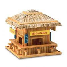 Beachcombing birdies will belly up to this adorable wood snack shack ! Just like a favorite seaside hangout compete with straw roof , signs and barstool perches Eucalyptus wood and plywood ; 8.25 x 8.