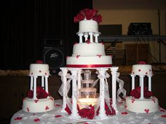 red and white wedding cakes with fountains | Red roses on white fondant where beautiful on this cake. The glowing ...