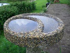cement and stones birdbath