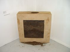 Hold : Mixed Media Installation. Concrete, wire and earth.