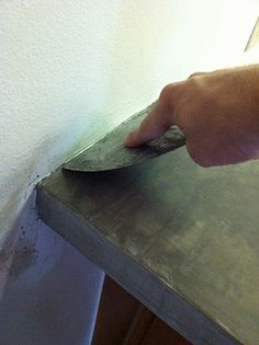 Laminate countertops turned concrete... great idea for inexpensive makeover