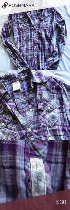 True Religion Button down shirt True Religion  Button up blouse Size: x-small Color: purple and white Materials: 100% cotton  Retail price: 125.00  Pre-owned excellent condition looks new no rips no stains True Religion Tops Button Down Shirts