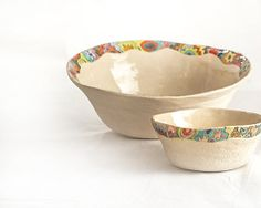 A handmade clay bowl edged with colorful drawings will liven up your table.