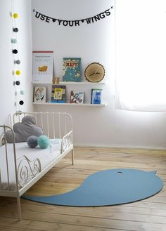 Banner above bookshelves to draw eyes up and create more balance