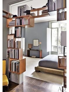 Look at these ultra cool free-form book shelves. Modern Master Bedroom - Find more amazing designs on Zillow Digs!