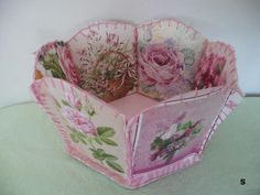 Made from old greeting cards.  My mother would make these as a gift basket filled with homemade cookies!