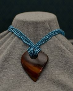 Beaded necklace with coconut shell pendant by SanaaAfrikaLLC, $10.00
