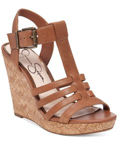 Vintage-inspired T-strap and platform wedge styling bring retro appeal to your office-to-weekend look in these Jenaa sandals from Jessica Simpson. | Leather or manmade uppers; manmade sole | Imported