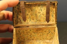 Another deceptively simple miniature brown trunk. But inside we see a fun, Alice in Wonderland paper in yellow.