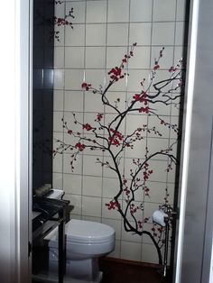 Japanese Cherry Blossoms decorate this tiled bathroom...I have it across the top of the wall instead of the side
