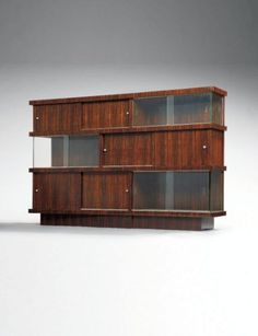 Jacques Adnet; Macasser Ebony and Glass Cabinets, c1933.