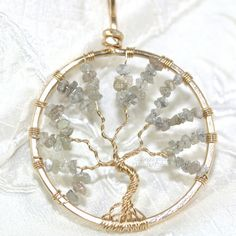 Diamonds! A girl's best friend, a sign of everlasting love & the most famous gemstone in the world. This 14k gf wire wrapped tree of life pendant features natural, rough diamonds & makes an amazing piece of wearable art! Ready to ship for someone special!