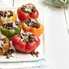 Tomatoes simply hollowed and stuffed with a delicious spiced ground beef filling make a gorgeous yet hearty summer dinner. Get the recipe.  - WomansDay.com
