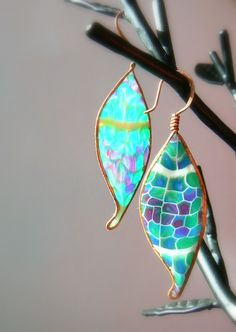 One of a kind hammered copper leaves with a lovely translucent slice of polymer cane give these earrings a modern twist. Brightly colored cane