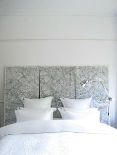A map headboard in back and white makes a statement without being overpowering in this room from47 Park Avenue.