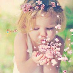 girl blowing flowers