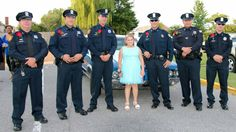 Policemen attend father-daughter dance with girl whose dad died in line of duty