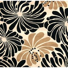Make a statement in your living room with this floral hand-tufted wool rug. It features a 0.5-inch pile and is crafted of blended wool, so it's comfortable to walk on, and it comes in neutral colors that will look great with your contemporary decor.