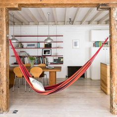 A hammock is the perfect place to recline and relax. Install an indoor hammock for beachy relaxation all year long. For more indoor hammock design ideas, visit domino. Indoor Hammock Bed, Backyard Hammock, Diy Hammock, Hanging Hammock, Hammock Stand, Hammock Ideas, Hanging Chairs, Hanging Beds, Hammocks