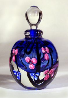 """Roger Gandelman Art Glass Perfume Bottle Pink Floral Blue Interior. Measures 4.75""""."""