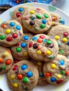 Soft and chewy cookies filled with colorful M&Ms. These are a cookie jar favorite! For extra color, press extra M&Ms into the tops of cookies before baking. Köstliche Desserts, Delicious Desserts, Dessert Recipes, Yummy Food, Tasty, Picnic Recipes, Picnic Ideas, Picnic Foods, Health Desserts