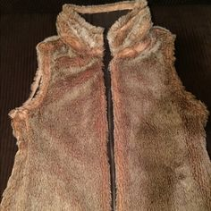 Faux Fur Reversible Vest: Cozy or City Shiek Perfect condition, Used a few times but really to warm for Florida...Brown on one side , soft Faux fur on other.. Two looks in one. Be Country Cozy or City Shiek 100% cotton on brown side, 80% acrylic/20% polyester on faux fur side. Buy 3 closet items get 15% discount    All clothes ship clean and are smoke free home.  All proceeds from sales are going to help two minor children who lost their single mom in a recent tragedy  Thank you. Have a…