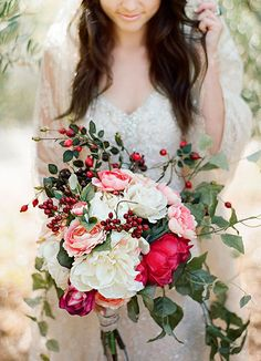 Add a few red berries to your wedding bouquet to make it festive for winter | Brides.com