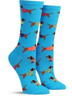 Wag your tail with enjoyment by slipping on these colorful dachshund socks adorned with sweaters in either mimosa yellow or blue lagoon.