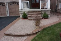Exposed Front Walk, Steps Liberty Tan Colour with Stamped Curbs and Border in Autumn Brown Colour