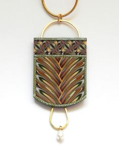Made by Sandra McCaw - polymer clay with gold leaf, gold wire and fresh water pearl