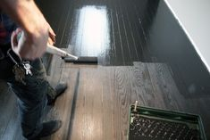 Great step-by-step on painting a wood floor black by Bye Bye, Brooklyn.