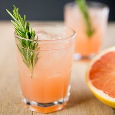 This rosemary greyhound cocktail recipe is a vodka grapefruit juice sweetened with a rosemary infused simple syrup. A pretty pink drink great for weddings.