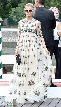Beautiful: Laura Bailey, 42,  flaunted her fantastic figure in a floor-length floral gown as she arrived in style at the Venice Film Festival on Wednesday