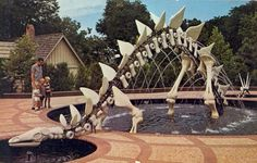 STEGOSAURUS FOUNTAINChildren's ZooLincoln, NebraskaThis unique fountain sets the pattern of one of the most attractive  Children's Zoos in the Country. It is symbolic of the long evolution of  animals from pre-historic times to the modern animals of today, as found  in this zoo.1960s. Evolution propaganda in Nebraska.